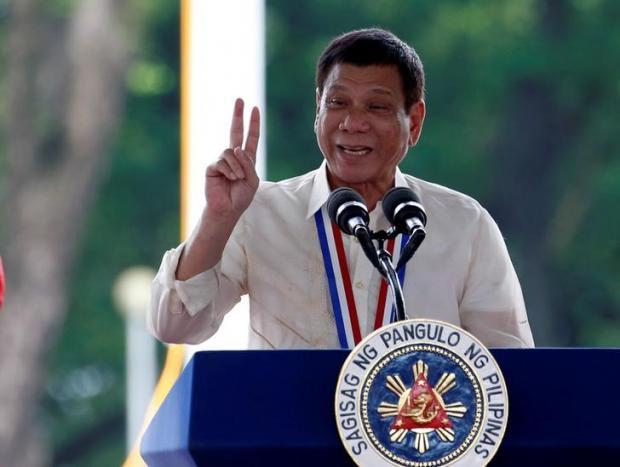 Philippine President Rodrigo Duterte speaks during a National Heroes Day commemoration at the Libingan ng mga Bayani (Heroes' Cemetery) in Taguig city, Metro Manila