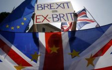 A British protestor holds up a placard during a pro-EU demonstration in downtown Rome